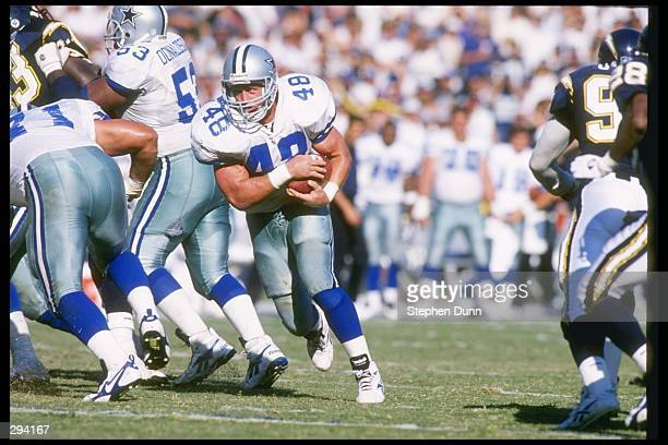 Running back Daryl Johnston of the Dallas Cowboys moves the ball during a game against the San Diego Chargers at Jack Murphy Stadium in San Diego...