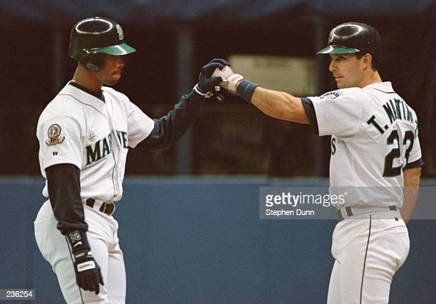 SEATTLE CENTER FIELDER KEN GRIFFEY JR. CELEBRATES WITH TEAMMATE TINO MARTINEZ, AFTER GREFFEY HIT A SOLO HOMERUN IN THE 8TH INNING, MAKING THE SCORE...
