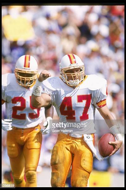 Tampa Bay Buccaneers defensive backs John Lynch and Melvin Johnson celebrate during a game against the Minnesota Vikings at Tampa Stadium in Tampa...