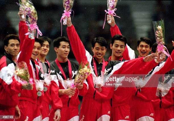 Team Japan poses for the camera as they show their medals during the World Gymnastics Championships in Sabae Japan