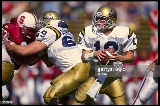 UCLA QUARTERBACK CADE MCNOWN DROPS BACK TO PASS DURING DURING THE BRUINS 4228 VICTORY OVER THE STANFORD CARDINAL AT STANFORD STADIUM IN STANFORD...