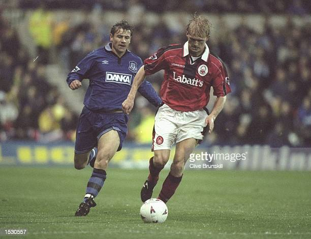 Andrei Kanchelskis of Everton chases Alf Ing Haaland of Forest during the FA Carling Premier league match between Nottingham Forest and Everton at...