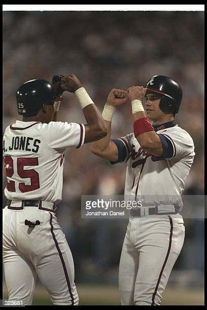 Atlanta Braves catcher Javier Lopez and Andruw Jones celebrate during a game against the St Louis Cardinals at Fulton County Stadium in Atlanta...