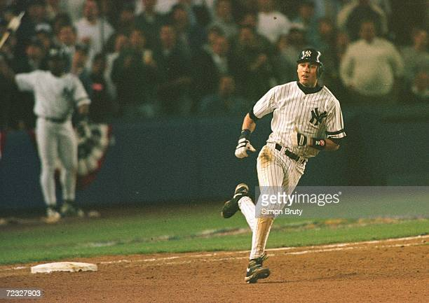 Batter Derek Jeter of the New York Yankees rounds first base after his controversial homerun in game one of the American League Championship Series...