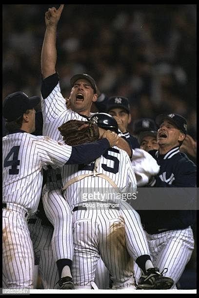 Closer John Wetteland of the New York Yankees celebrates with teammates after Game Six of the World Series against the Atlanta Braves at Yankee...