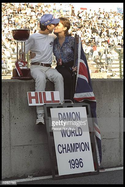 Damon Hill and wife Georgie kiss to celebrate his success during the Japanese grand prix at Suzuka, Japan. Mandatory Credit: Pascal Rondeau/Allsport