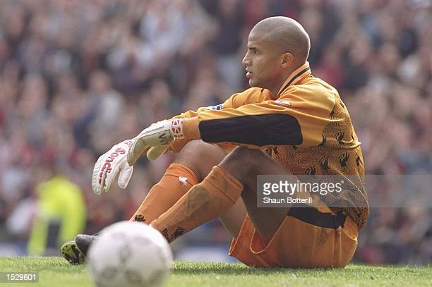 David James of Liverpool sits dejected after United score the only goal of the game during the Carling Premier league match between Manchester United...