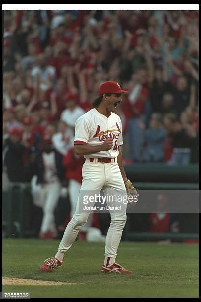 Dennis Eckersley of the St Louis Cardinals looks on during a playoff game against the Atlanta Braves at Busch Stadium in St Louis Missouri The...
