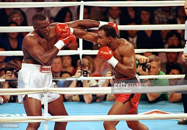 24 Oct 1996 Evander Holyfield lands a right punch during the fight against James Buster Douglas Mandatory Credit Mike Powell /Allsport