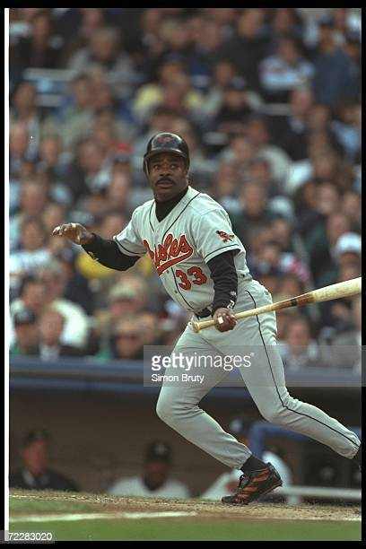 First baseman Eddie Murray of the Baltimore Orioles watches the ball fly during a playoff game against the New York Yankees at Yankee Stadium in New...