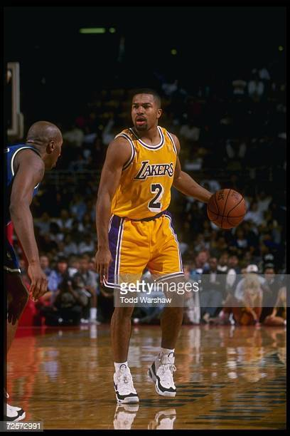 Guard Derek Fisher of the Los Angeles Lakers moves the ball during a game against the Dallas Mavericks at Selland Arena in Fresno California The...