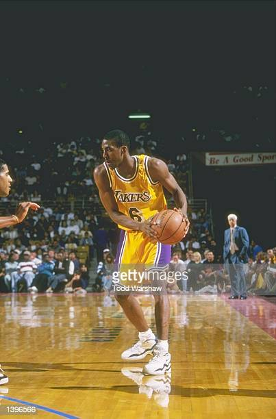 Guard Eddie Jones of the Los Angeles Lakers holds the ball during a game against the Dallas Mavericks at the Selland Arena in Frenso California The...