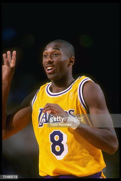 Guard Kobe Bryant of the Los Angeles Lakers celebrates during a game against the Dallas Mavericks at Selland Arena in Fresno California The Lakers...