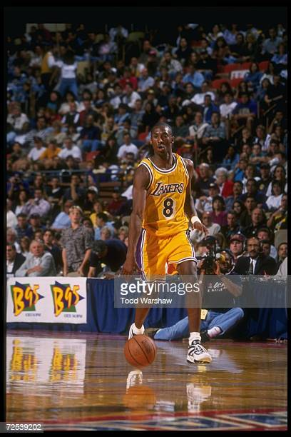 Guard Kobe Bryant of the Los Angeles Lakers moves down the court during a game against the Dallas Mavericks at Selland Arena in Fresno California The...