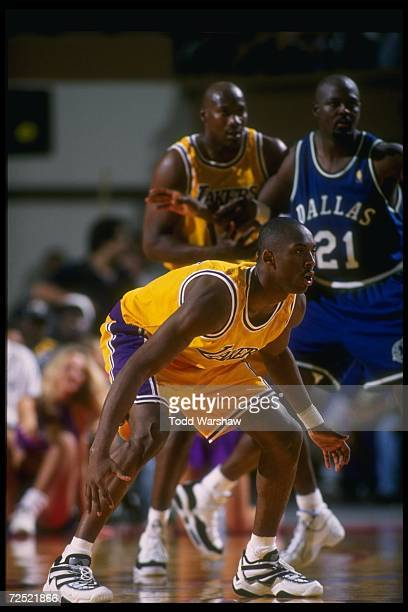 Guard Kobe Bryant of the Los Angeles Lakers plays defense during a game against the Dallas Mavericks at Selland Arena in Fresno California The Lakers...