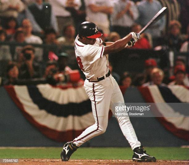 Jermaine Dye of the Atlanta Braves hits a sacrifice fly to score Fred McGriff in the first inning of game 6 of the National League Championship...