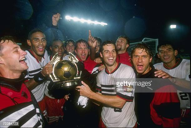 John Harkes of DC United along with his teammates celebrate after the United 32 Major League Soccer MLS Championship Game win over the Los Angeles...