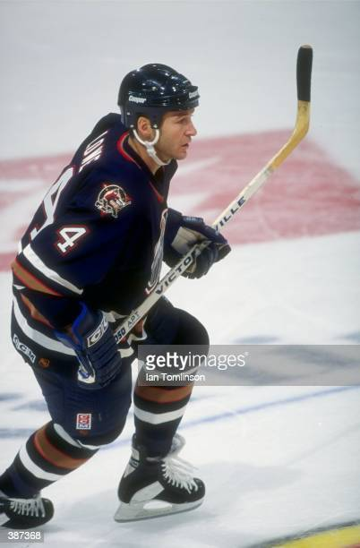 Kevin Lowe of the Edmonton Oilers in action during a game against the Calgary Flames at the Canadien Airlines Saddledome in Calgary Canada Mandatory...