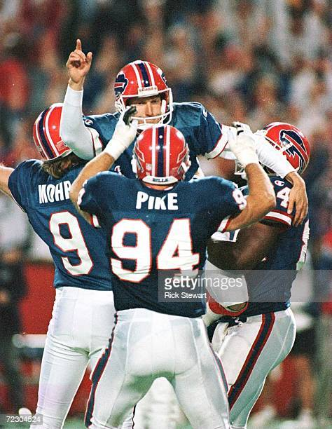 Kicker Steve Christie of the Buffalo Bills is carried off by his teammates after kicking the game winning field goal with 538 left in overtime...