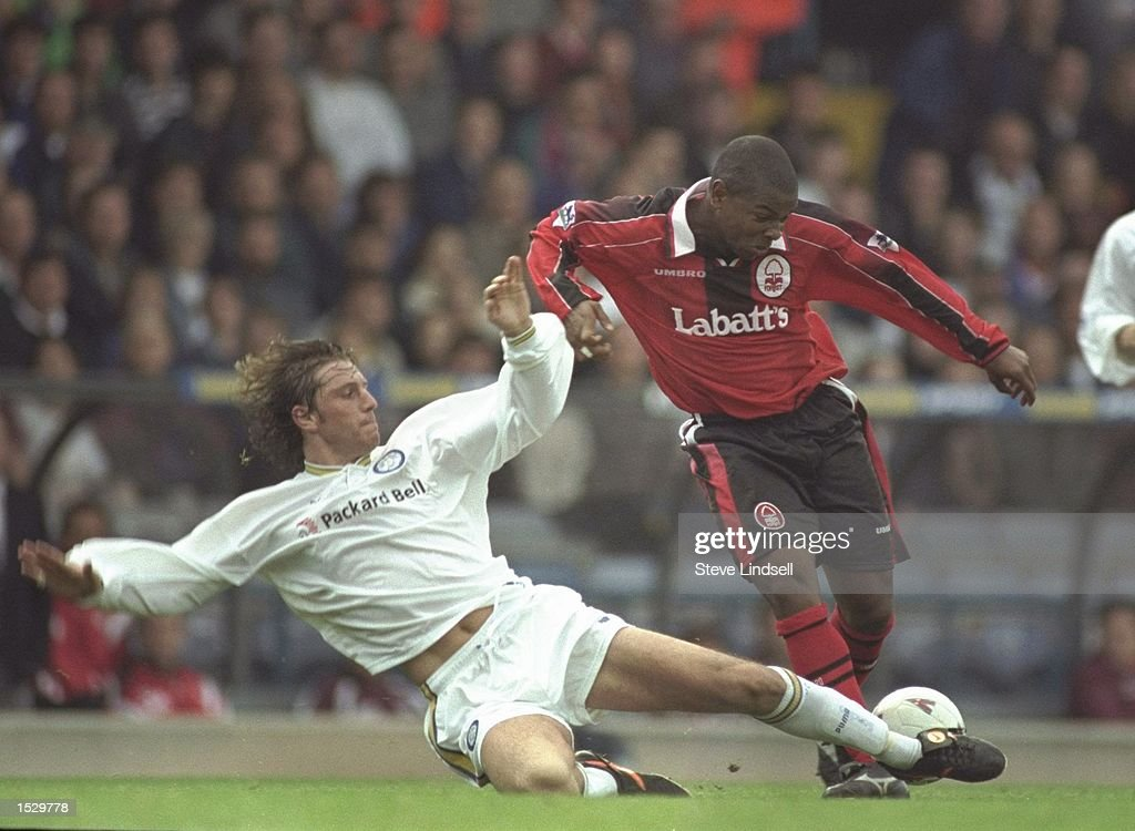 Lee Sharpe of Leeds United (left) slides in to tackle Des Lyttle of Nottingham Forest during the FA Carling premier league match between Leeds United and Nottingham Forest at Elland Road in Leeds. Leedswent onto win the match by 2-0. Mandatory Credit: Steve Lindsell/Allsport