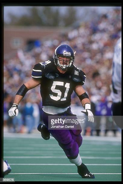 Linebacker Pat Fitzgerald of the Northwestern Wildcats moves down the field during a game against the Illinois Fighting Illini at Dyche Stadium in...