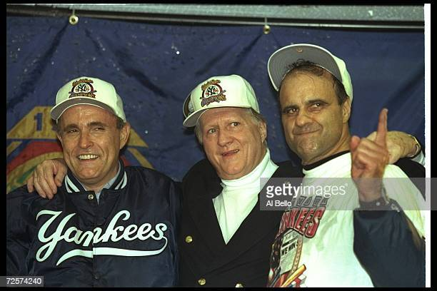 New York City mayor Rudy Guilliani George Steinbrenner and New York Yankees manager Joe Torre celebrate after Game Six of the World Series against...