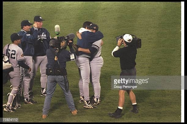 New York Yankees pitchers John Wetteland and Andy Pettitte embrace after Game Five of the World Series against the Atlanta Braves at Fulton County...
