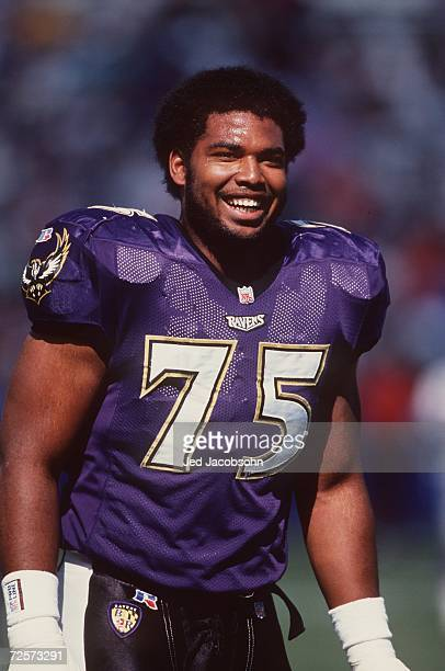 Offensive lineman Jonathan Ogden of the Baltimore Ravens in action on the field as he shares a smile with teammates during pre game warmups before...