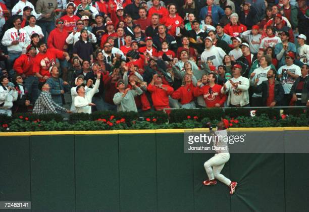 Outfielder Brian Jordan of the St Louis Cardinals scales the outfield wall for a Ken Caminiti of the San Diego Padres home run in game 2 of the...