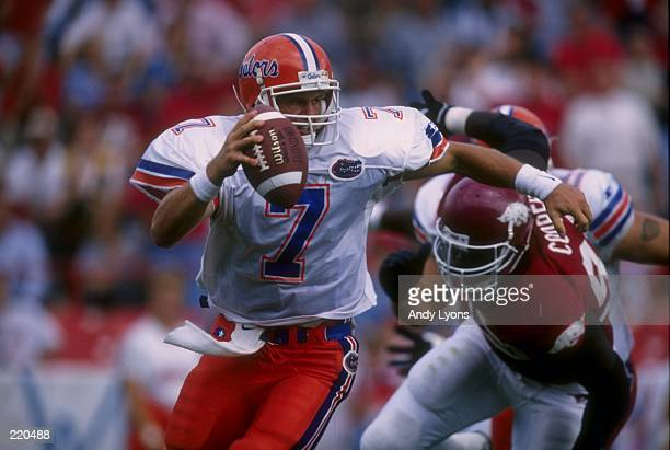 Quarterback Danny Wuerffel of the University of Florida scrambles out of the pocket during the Gators 427 win over the University of Arkansas at...