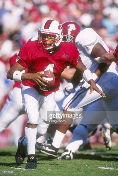 Quarterback Jamie Barnette of the North Carolina State Wolfpack pitches to the tailback on the option play during Wolfpack's 2419 loss to the Alabama...