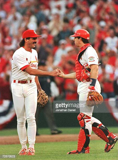 Relief pitcher Dennis Eckersley of the St Louis Cardinals is congratulated by catcher Tom Pagnozzi after recording the final out in the Cardinals 32...