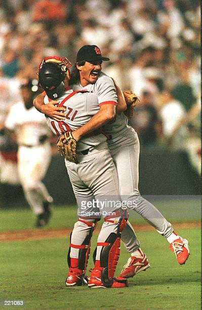Relief pitcher Dennis Eckersley of the St Louis Cardinals hugs catcher Tom Pagnozzi in celebration after recording the final out of the Cardinals 75...