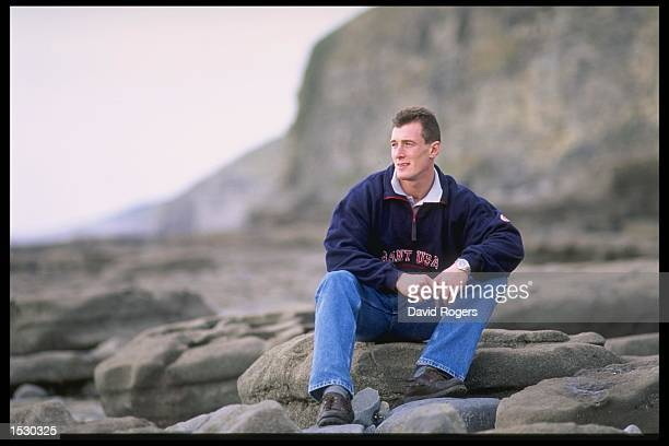 Robert Howley the Cardiff and Wales scrum half sits on the rocks during a feature on the beach at his hometown of Bridgend in Wales Mandatory Credit...