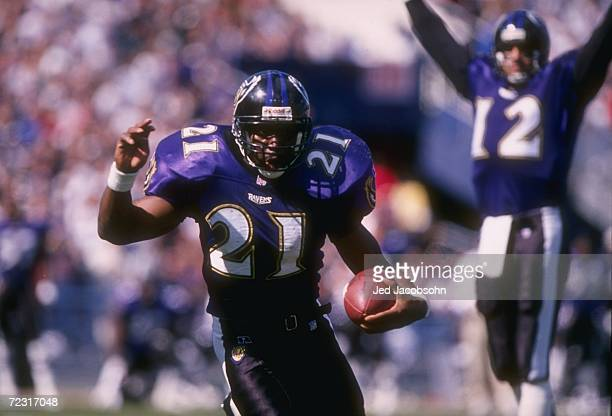 Running back Earnest Byner of the Baltimore Ravens keeps his eyes focused up field as makes a cut to the outside to avoid pursuing tacklers from the...
