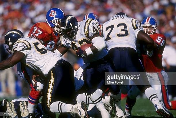 Running back Leonard Russell of the San Diego Chargers keeps his eyes focused up field as he makes a break through a hole in the offensive line...
