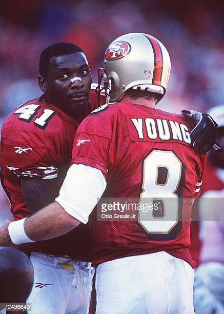 Running back Terry Kirby hugs quarterback Steve Young of the San Francisco 49ers during the 49ers 2821 win over the Cincinnati Bengals at 3Com Park...