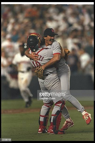 St Louis Cardinals catcher Tom Pagnozzi and Dennis Eckersley celebrate during a game against the San Diego Padres at Jack Murphy Stadium in San Diego...