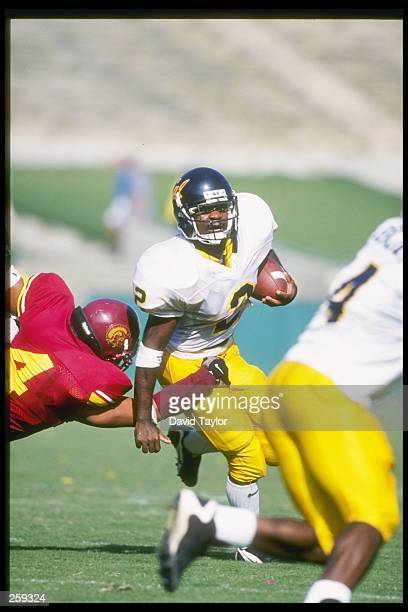 Tailback Brandon Willis of the California Bears runs down the field during a game against the Southern California Trojans at the Los Angeles Coliseum...
