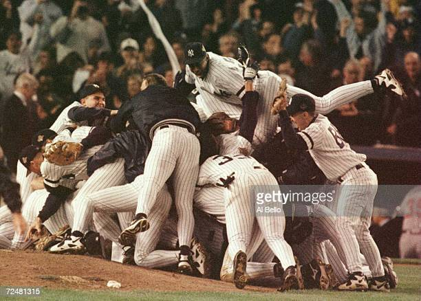 The New York Yankees celebrate their 31 victory over the Atlanta Braves to take the World Series in game 6 of the World Series at Yankee Stadium in...