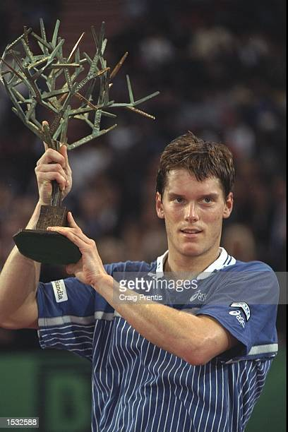 Thomas Enqvist of Sweden holds aloft the trophy after defeating Yevgeny Kavfelnikov of Russia 62 64 75 in the final of the ATP tour Mercedes super...