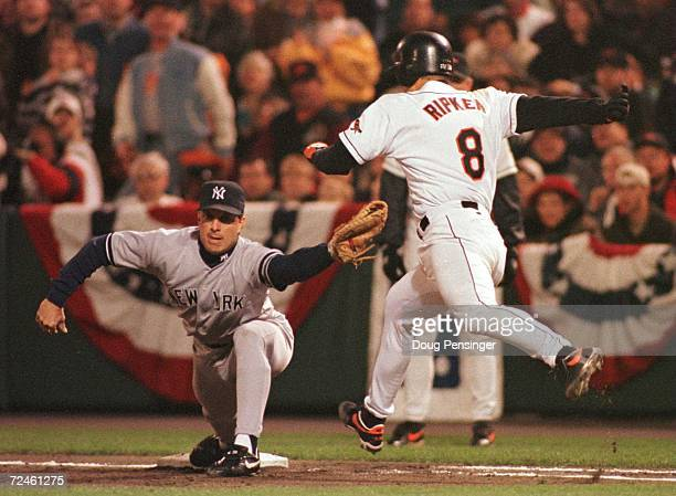 Tino Martinez of the New York Yankees makes a catch at first base to force out Cal Ripken Jr of the Baltimore Orioles in the third inning of Game 4...