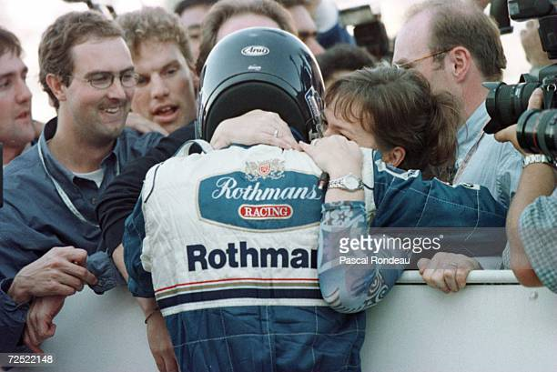 Williams driver Damon Hill gets a big hug from wife Georgie as he celebrates winning the Japanese Formula One Grand Prix and the Formula One World...