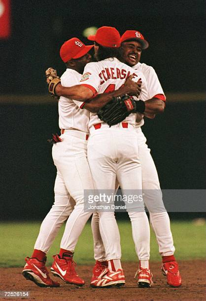 Willie McGee Dennis Eckersley and Brian Jordan of the St Louis Cardinals celebrates after defeating the Atlanta Braves in game 4 of the National...