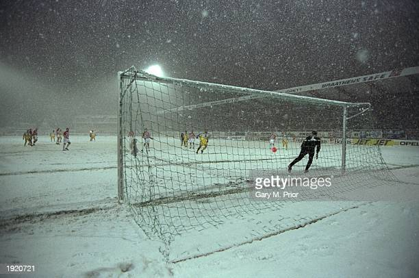 A general view of action from the snow ridden European Cup Winners Cup first leg match between Tromso and Chelsea at Tromso in Norway Tromso won the...