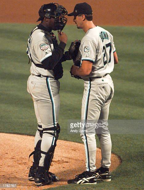 Catcher Charles Johnson of the Florida Marlins chats with pitcher Kevin Brown after Brown gave up a run during the first inning against the Atlanta...