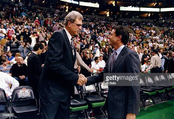 Coach Phil Jackson of the Chicago Bulls shakes hands with coach Rick Pitino of the Boston Celtics after a game at the Fleet Center in Boston...