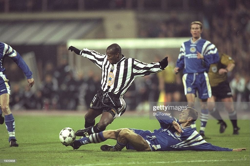 Faustino Asprilla of Newcastle United (centre) is tackled during the Champions League match against Dynamo Kiev in Kiev, Ukraine. The match was drawn 2-2. \ Mandatory Credit: Stu Forster /Allsport