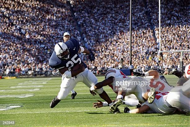 Fullback Aaron Harris of the Penn State Nittany Lions falls forward with the ball during a game against the Ohio State Buckeyes at Beaver Stadium in...