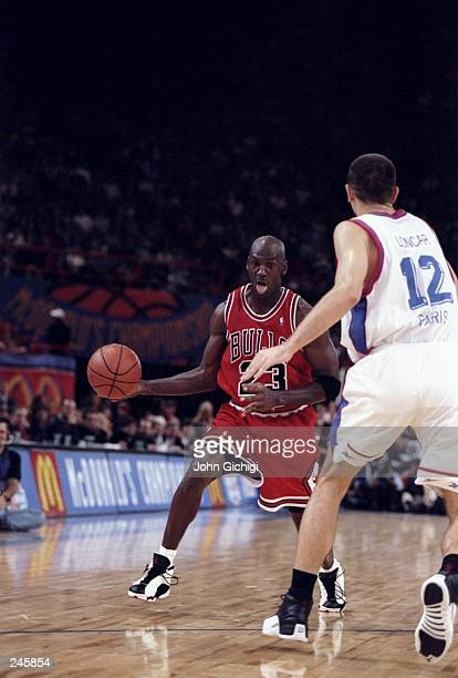 Guard Michael Jordan of the Chicago Bulls dribbles around the perimeter as Mikola Loncar of PSG Racing watches during the McDonald''s Championships...